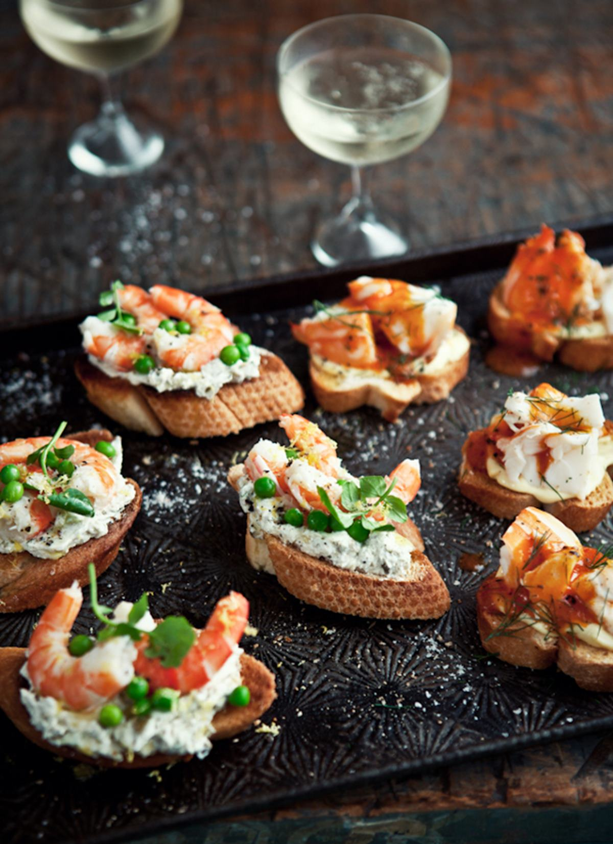 Fresh Prawn Crostini with Caper, Green Olive, Goat's Cheese Paste, Baby Peas & Lemon Oil
